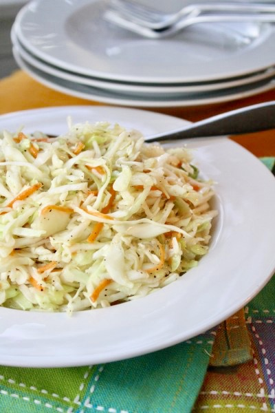 Learn how to pack a picnic perfectly and get a delicious, simple, picnic-perfect Oil & Vinegar Cole Slaw recipe. No worries about mayo sitting out!