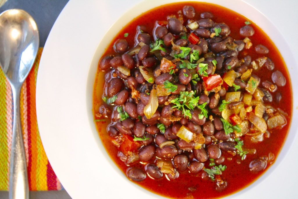 Chorizo & Black Bean Stew is quick to make and will light up your kitchen with its glorious aroma. My absolute favorite thing is the way the tiniest bits of chorizo melt away into the stew, so even if you get a broth-only spoonful, its flavor is still there. A hint of dried paprika – use a smoked paprika for a more intense flavor – rounds out the spice of the sausage and completes this perfect bowl.
