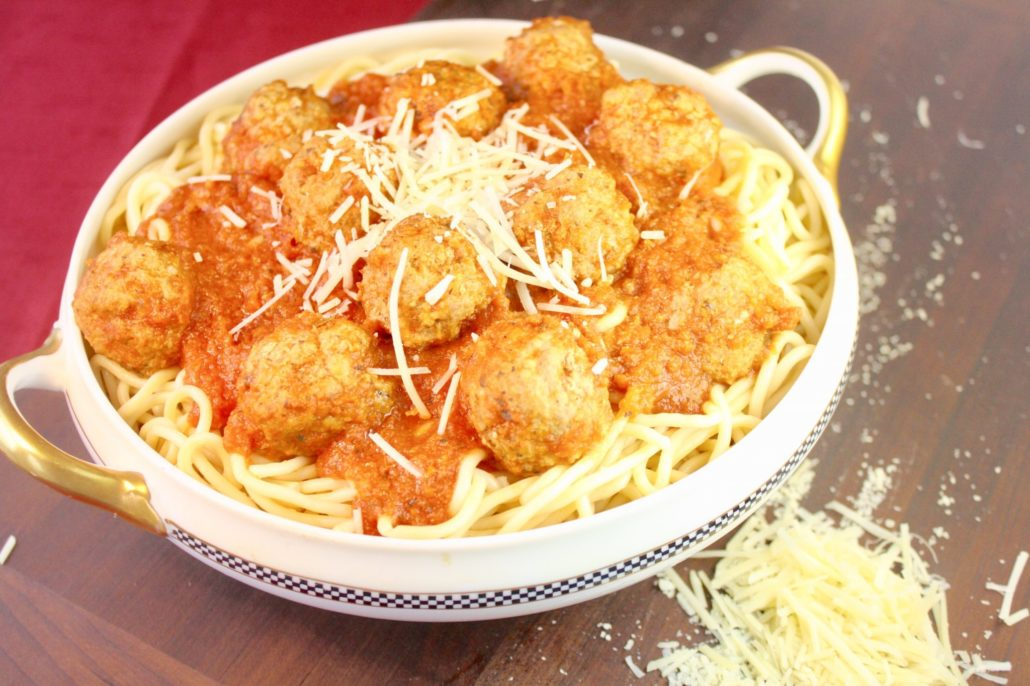 Ground turkey vs ground beef, turkey is tops in this Spaghetti & Turkey Meatballs recipe. Tender turkey meatballs gently simmered in a quick tomato sauce and you can have a hearty meal on the table in no time!!
