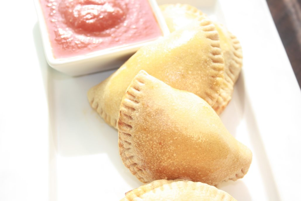 Easy Pizza Pockets are the dish that keeps on giving.  They're easily customizable. Have a picky eater? These are a perfect snack or dinner choice because you can fill them YOUR favorite pizza toppings - sausage, sautéed mushrooms, even pineapple.